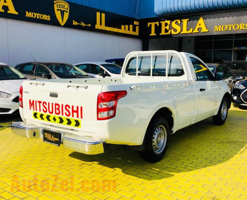 ///LOW MILLAGE///MITSUBISHI L200///2016///GCC///WARRANTY///LIKE BRAND NEW///ONLY 633 DHS MONTHLY///
