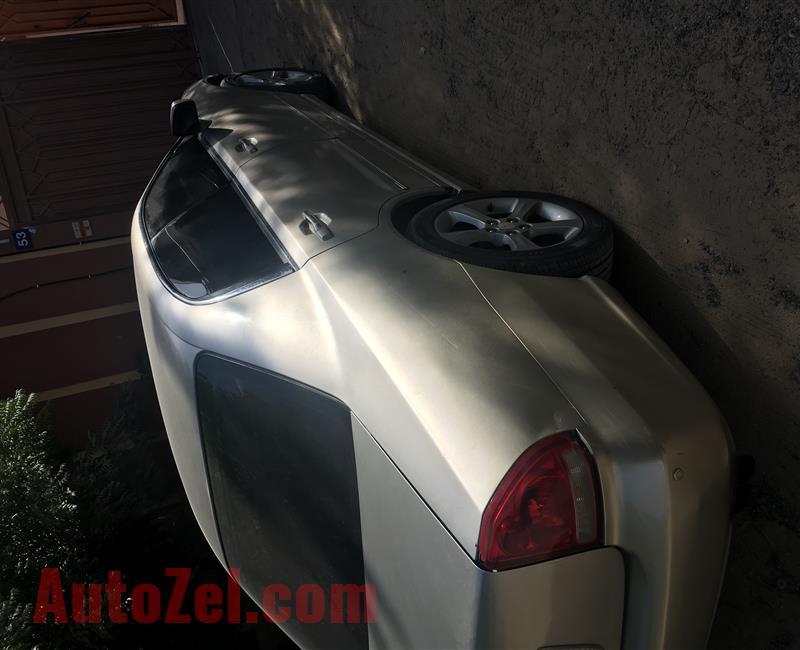 متسوبيشي ماجنا 2005 ذهبي - AED 6,000