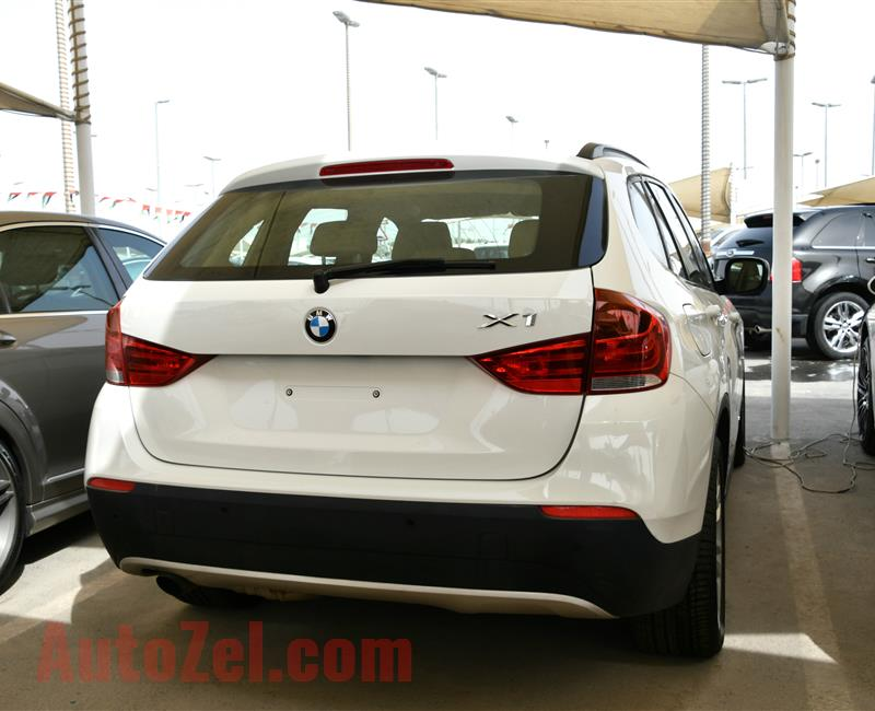 BMW X1- 2011- WHITE- 100 000 KM- GCC SPECS
