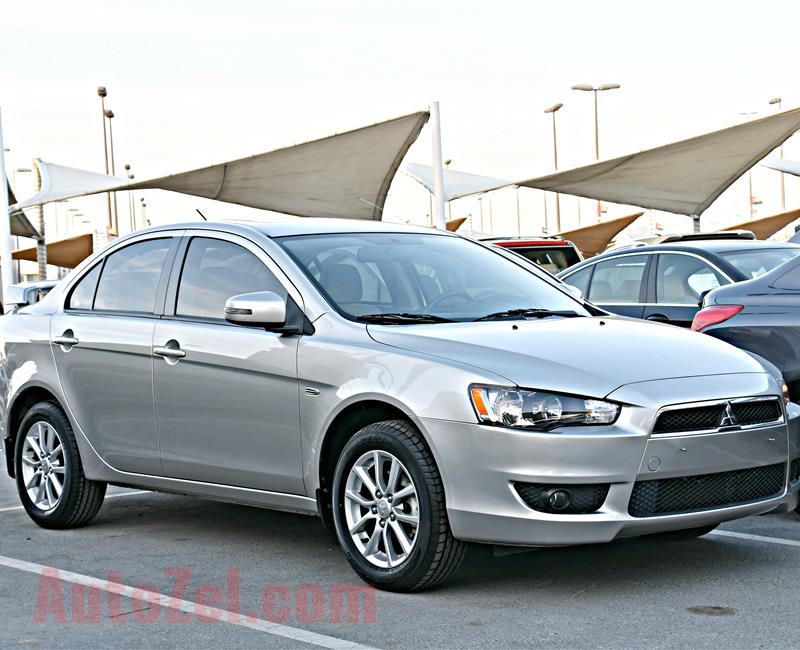 MITSUBISHI LANCER MODEL 2016 - SILVER - 24,000 KM - V4 - GCC
