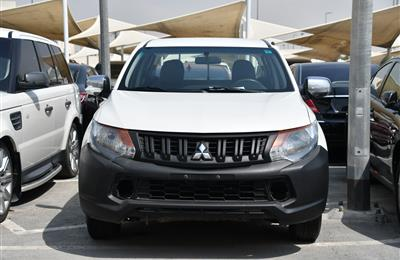 MITSUBISHI L200 PICK UP- 2016- WHITE- 180 000 KM- GCC